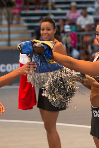 Cheerleaders give gift to fans at the San Juan Masters 10-11 August 2013 FIBA 3x3 World Tour, San Juan, Puerto Rico
