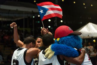 With puerto rican flag and mascot at the San Juan Masters 10-11 August 2013 FIBA 3x3 World Tour, San Juan, Puerto Rico