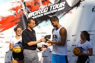 6 Tomo čajič (SLO) - Ljubljana accepts their FIBA 3x3 World Tour Saskatoon award.