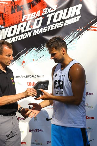 6 Tomo čajič (SLO) - Ljubljana accepts their FIBA 3x3 World Tour Saskatoon award.