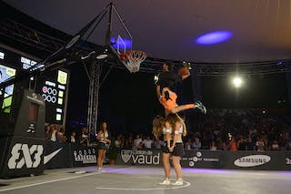 Dunking over two cheerleaders at the dunk contest 2013 FIBA 3x3 World Tour Masters in Lausanne
