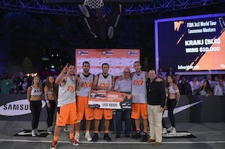 Patrick Baumann giving check to Kranj (Slovenia) winner 2013 FIBA 3x3 World Tour Masters in Lausanne